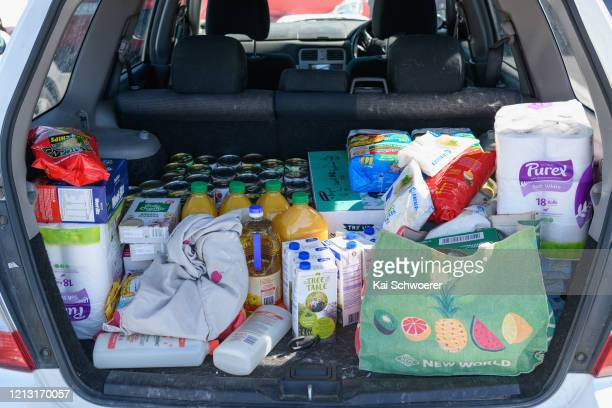 A car boot full of grocery shopping is seen at a supermarket car park on March 18 2020 in Christchurch New Zealand New Zealand now has 20 confirmed...