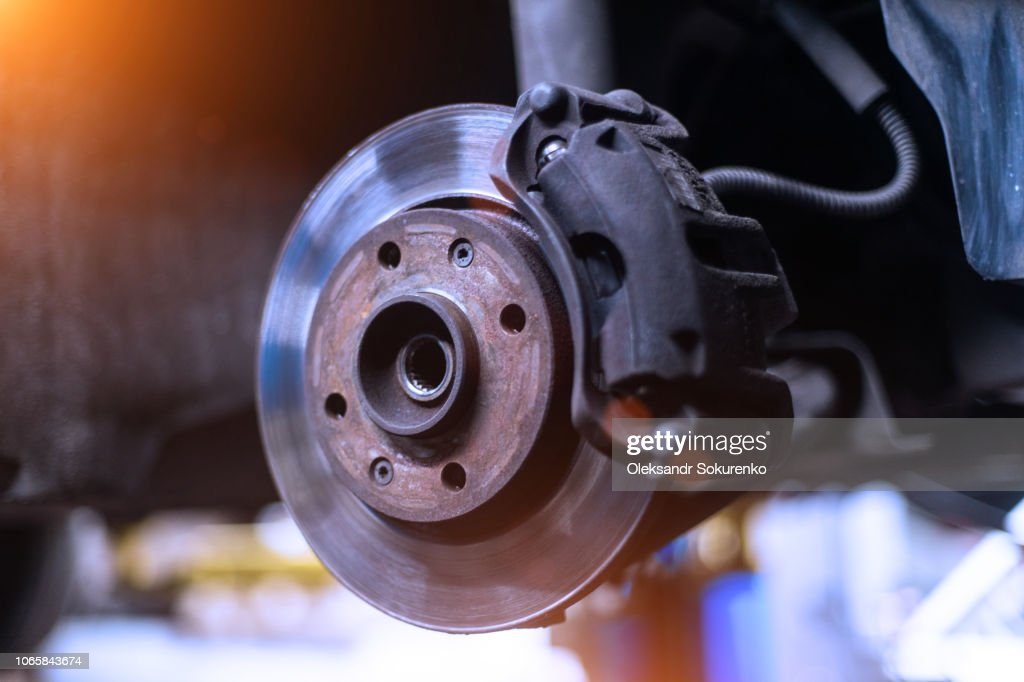 Car brake disk and caliper close up without wheel in cold colors with beautiful backlight : Stock Photo