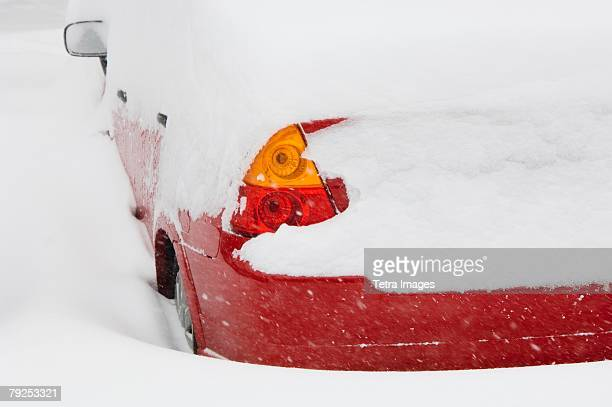 Car buried in snow in winter