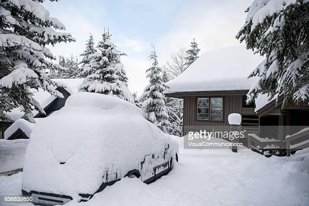 Car buried under snow.