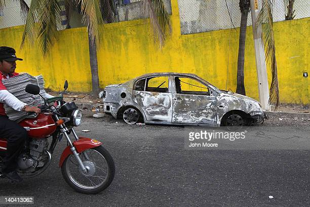 Car burned in drug violence sits abandoned on March 1, 2012 in Acapulco, Mexico. Drug-related violence surged in the coastal resort last year, making...