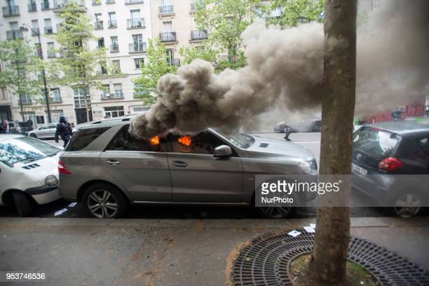 A car burning during the May Day rally in Paris Thousands of persons between 20 000 and 55 000 have gathered in the Streets of the French capital...