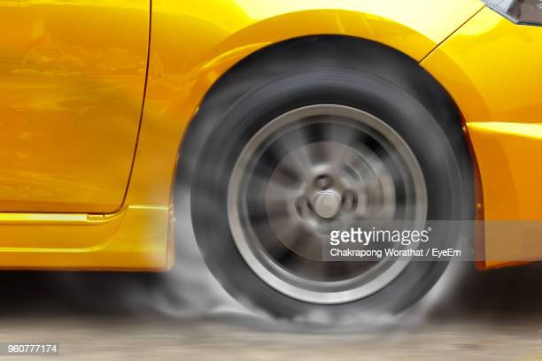 car burnout during drag race - spinning stock pictures, royalty-free photos & images