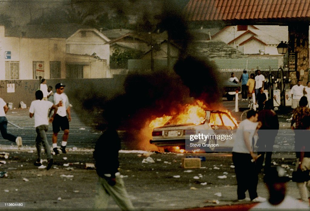 A car burns as looters take to the streets at the intersection of Florence and Normandie Avenues, April 29, 1992, This intersection is considered the flashpoint of the Los Angeles riots.