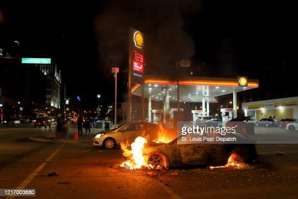 Car burns at the corner of Martin Luther King Boulevard and Tucker Boulevard on Tuesday, June 2, 2020. After a peaceful day of protests things...