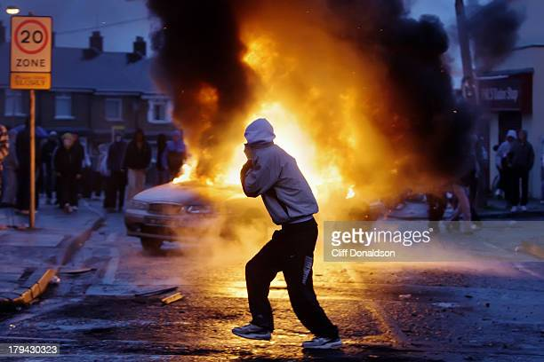 CONTENT] A car burns during disturbances at the Ardoyne area of north Belfast Picture Cliff Donaldson