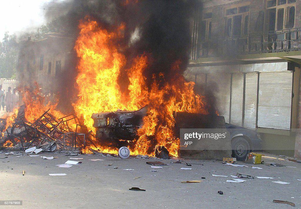 A car burns in the street as Afghan stud : News Photo