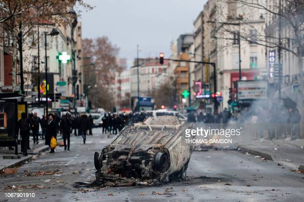 TOPSHOT A car burns outside the Lycee Professionnel JeanPierre Timbaud high school after being set ablaze by students protesting against French...