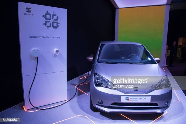 A car by Spanish automobile manufacturer Seat is pictured at the Seat's stand on the first day of the Mobile World Congress in Barcelona on February...
