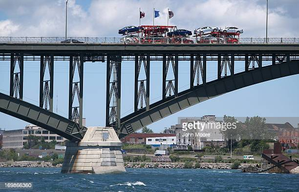 A car carrier crosses the Peace Bridge over the Niagara River on the USCanada border on June 3 2013 in Buffalo New York US Customs and Border...
