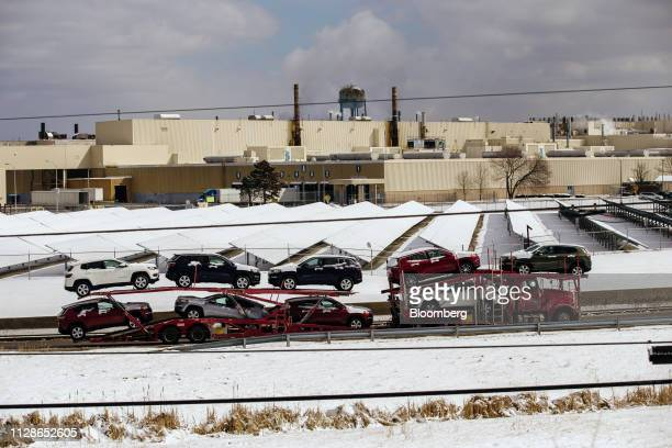 A car carrier trailer hauls vehicles past the General Motors Co Lordstown production plant complex in Lordstown Ohio US on Monday March 4 2019 The...