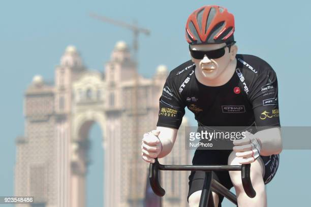 A car carries a promotional Tour of Abu Dhabi mannequin wearing one of Tour's Jerseys with a background view of Fairmont Hotel construction site On...