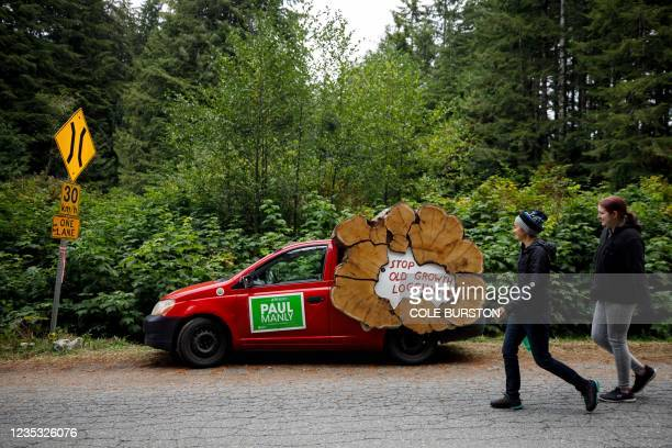 Car carries signs for Green Party candidate Paul Manly at the base of the anti-old growth logging protest of the Fairy Creek watershed in Port...