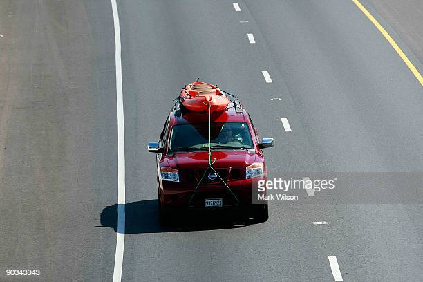 Car carrying a Kayak travels over the Woodrow Wilson Bridge on September 4, 2009 in National Harbor, Maryland. The American Automobile Association is...