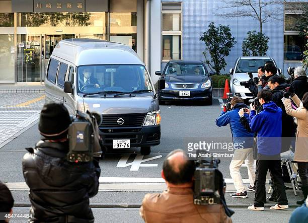 A car carrying arrested teenages leaves Kawasaki Police Station for prosecutor's office on February 28 2015 in Kawasaki Japan Three teenagers one...