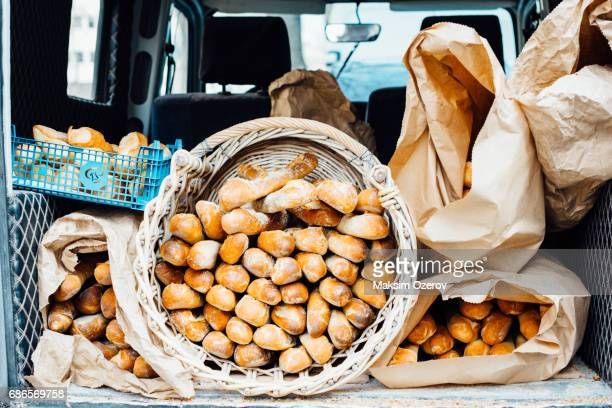 Car carrying baguettes in Paris, France