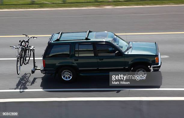 Car carrying bicycles travels over the Woodrow Wilson Bridge on September 4, 2009 in National Harbor, Maryland. The American Automobile Association...
