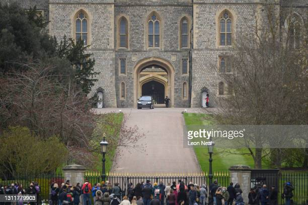 Car carrying Prince Edward is seen as people lay floral tributes to Prince Philip, Duke Of Edinburgh who died at age 99, outside Windsor Castle on...