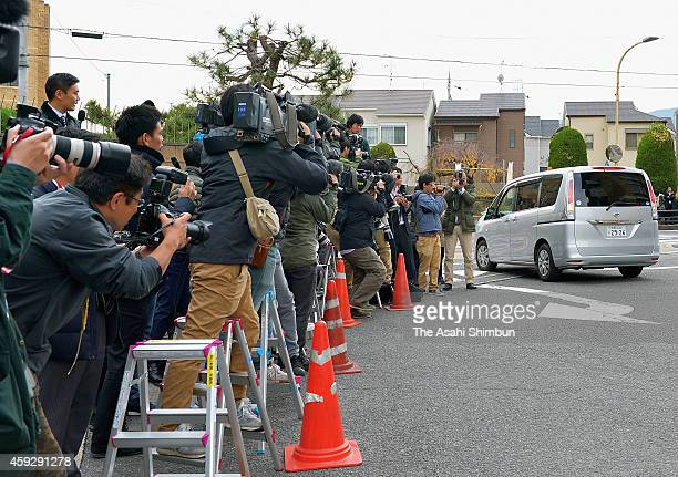 A car carrying suspect Chisako Kakehi leaves Mukomachi Police to station to send her to prosecutors on November 20 2014 in Muko Kyoto Japan Police...