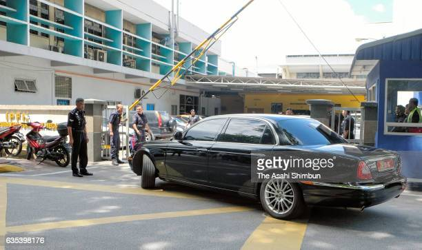 A car carrying the North Korean Ambassador to Malaysia Kang Chol arrives at the forensic department of Kuala Lumpur General Hospital where the body...