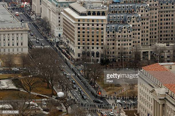 A car carrying US President Barack Obama and US Presidenelect Donald Trump drives along 15th St as they head toward the Capital Building for the...