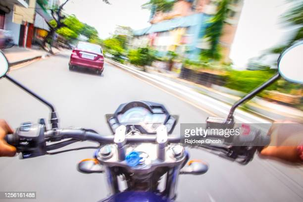 car chase by bike on street - オートバイ競技 ストックフォトと画像