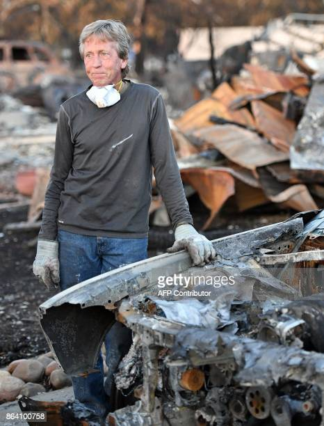 Car collector Gary Dower speaks with neighbors at his firedestroyed home in Santa Rosa California on October 20 2017 Residents are being allowed to...