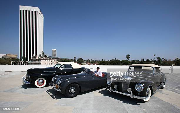 Car collector/Global Icons CEO Jeff Lotman poses with his 1949 Jaguar XK 120 and the Petersen's 1941 Cadillac Series 62 Coupe and a 1957 Mercedes...
