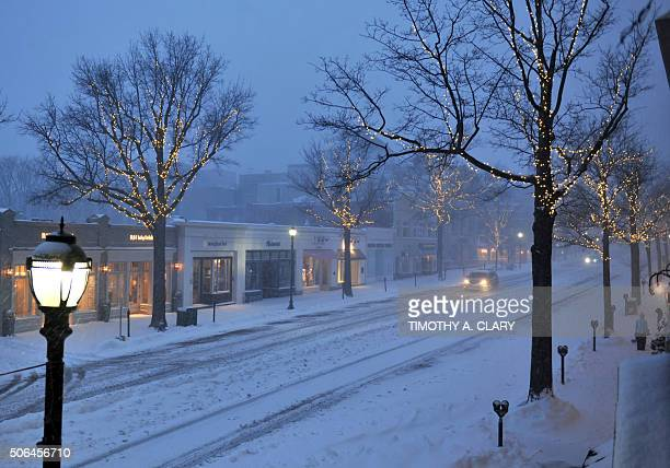 A car comes down a deserted Greenwich Avenue in Greenwich Connecticut January 23 2016 A deadly blizzard with bonechilling winds and potentially...