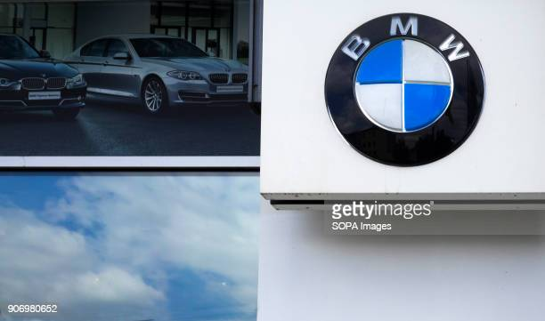 BMW car company logo in front of dealership building Bayerische Motoren Werke AG commonly known as BMW is a German automobile motorcycle and engine...
