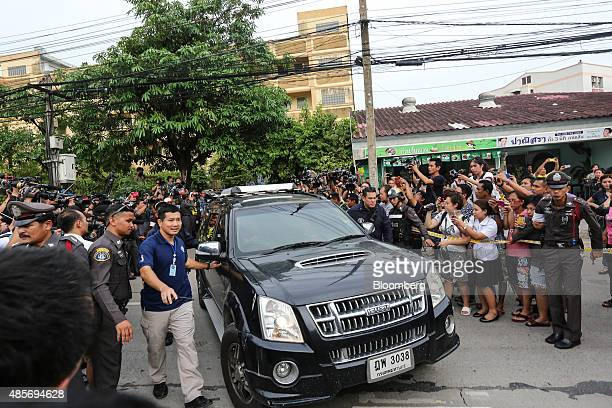 Car containing a suspect of the August 17 Bangkok shrine bombing leaves the building where he was detained, in Nong Chok, North West of Bangkok,...