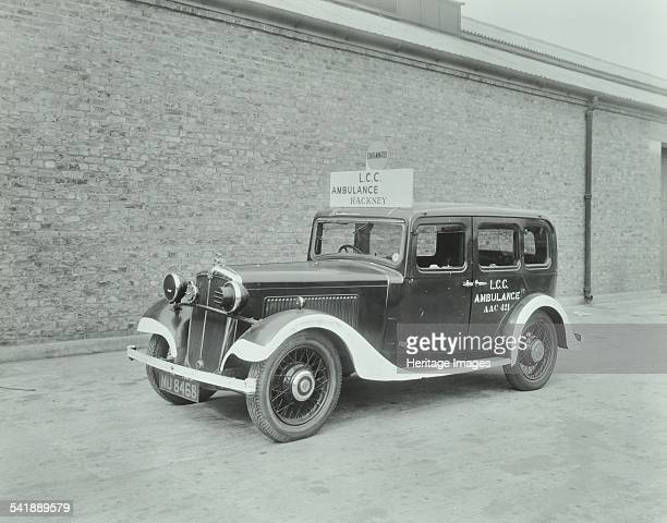 Car converted into London County Council ambulance Wandsworth Depot 1940 On the side of the car and written on a sign on its roofare the words 'LCC...