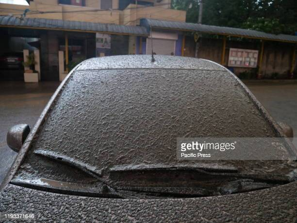 A car covered almost an inch thick of mud during the rain while Taal Volcano spilling ashes in the Town of Talisay and nearby towns as early as 430 pm