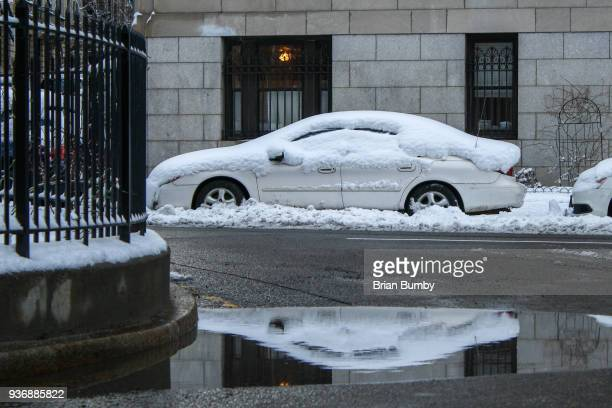 Car covered in snow on street