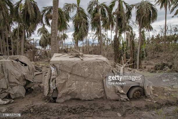 A car covered in volcanic ash from Taal Volcano's eruption is seen on January 17 2020 in Tanauan Batangas province Philippines The Philippine...
