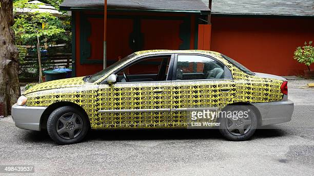 A car covered with bumper stickers from The Mystery Spot in Santa Cruz California USA
