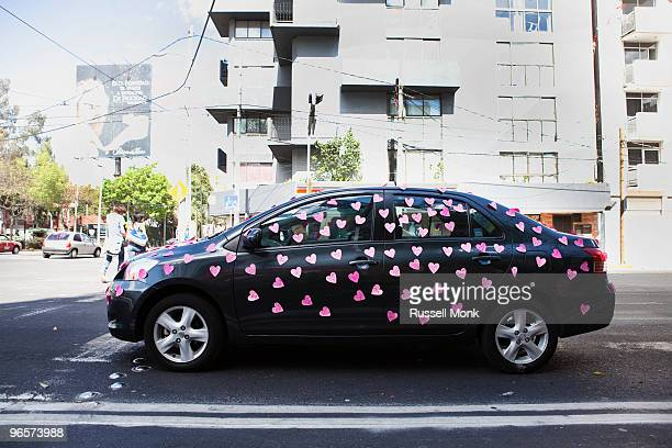 Car covered with paper hearts