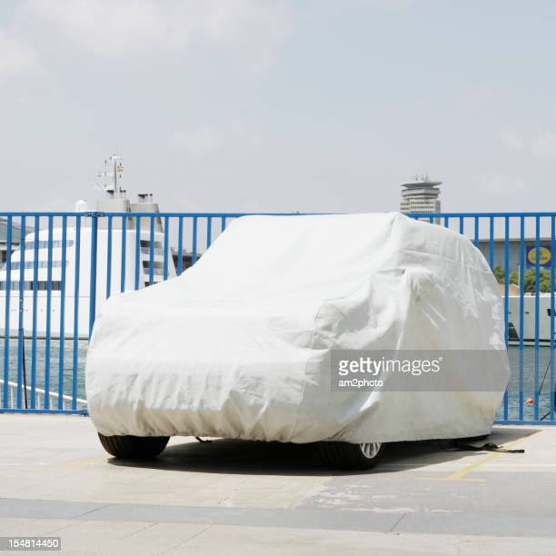 Car covered with protective sheet