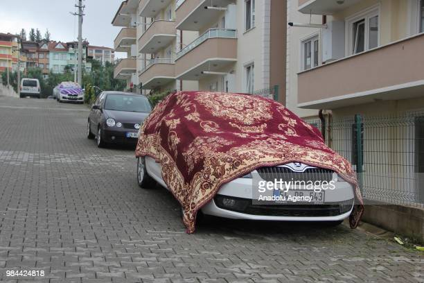 A car covered with rugs to protect it from possible hail damage is seen as Turkish State Meteorological Service issued a warning on heavy rainfall in...