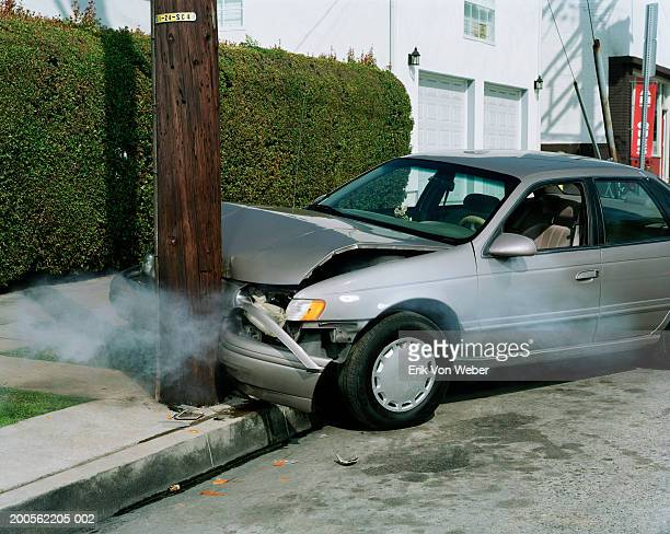 car crash against telephone pole by road - crash stock pictures, royalty-free photos & images