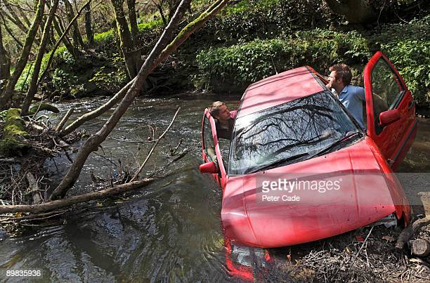 Car crashed into river with two passengers