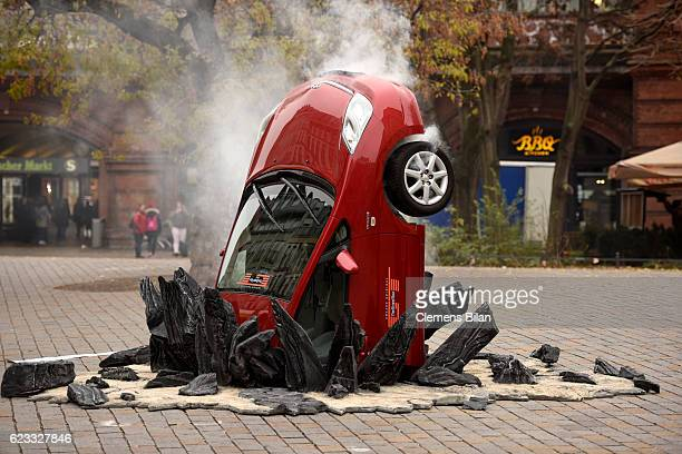 A car 'crashed' into the ground at Hackescher Markt in Berlin Germany on November 15 ahead of the launch of Jeremy Clarkson Richard Hammond and James...