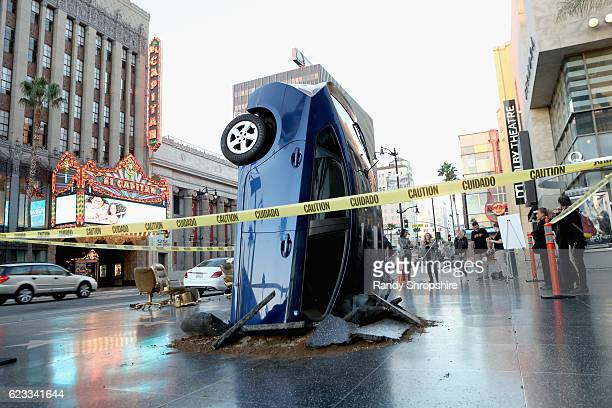 A car 'crashed' into the ground on November 15 2016 at the Walk of Fame in Hollywood California ahead of the launch of Jeremy Clarkson Richard...