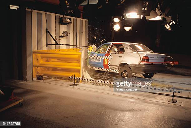 A car crashes into a wall during a crash test at the Renault technical center