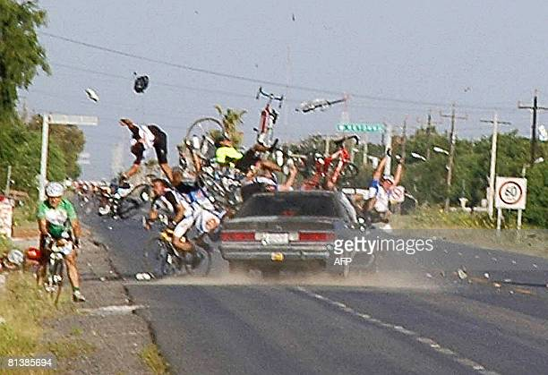 A car crashes into several cyclists participating in a race in the city of Matamoros northern Mexico on June 1 2008 One person was killed and 14...