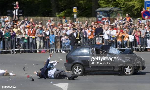 A car crashes into the crowd waiting for the visit of the royal family in Apeldoorn on April 30 2009 Dutch Queen Beatrix and royal family members...