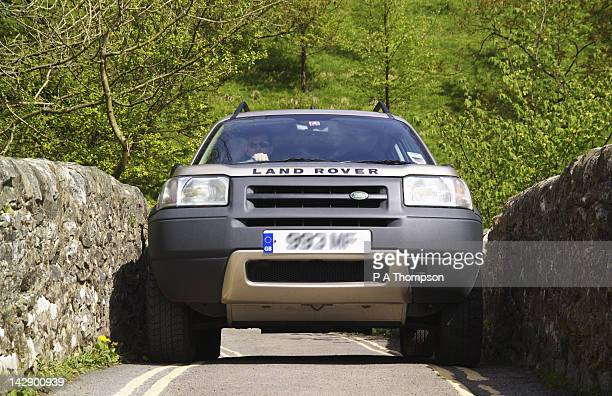 Car crossing a Pack Horse Bridge, Stainforth, Ribblesdale, North Yorkshire, England