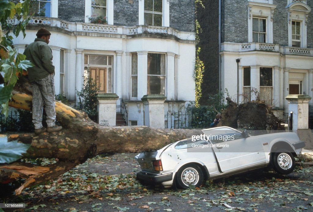 A car crushed by a fallen tree in England, in the aftermath of the Great Storm of 1987, 17th October 1987.