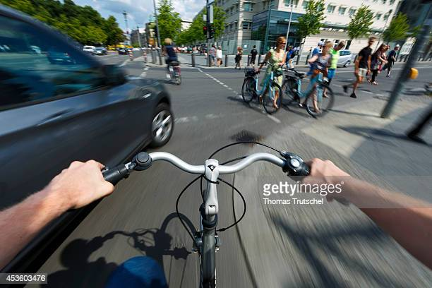 Car cutting in on a cyclist on the road on August 05 in Berlin Germany Pedestrians and cyclists are particularly at risk in traffic