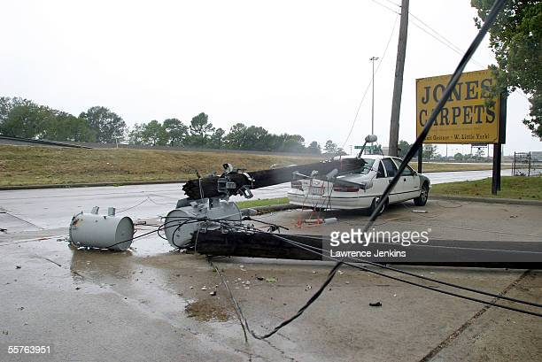 A car damaged by a downed telephone pole sits in a parking lot September 24 2005 in Houston Texas Hurricane Rite made landfall near the...